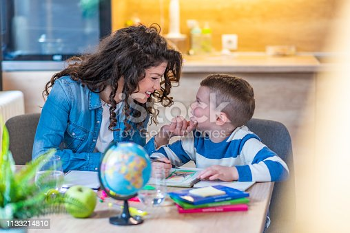 858130938 istock photo A Mother Helping Son for the Homework at home 1133214810