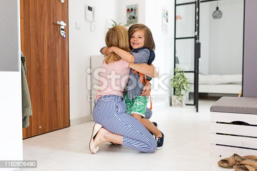 istock Mother helping son get ready for school 1152826490