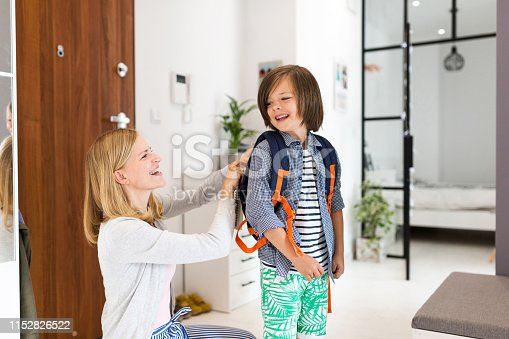 istock Mother helping son get ready for school 1152826522
