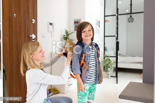 istock Mother helping son get ready for school 1152826527