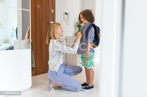 istock Mother helping son get ready for school 1152826592
