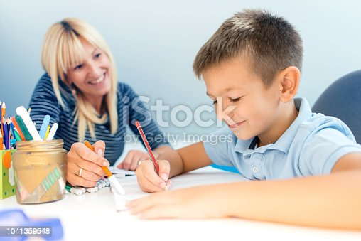 istock Mother helping son with homework 1041359548