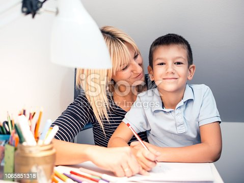 istock Mother helping son with homework 1065851318