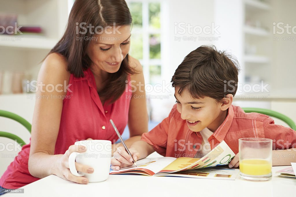 Mother Helping Son With Homework stock photo