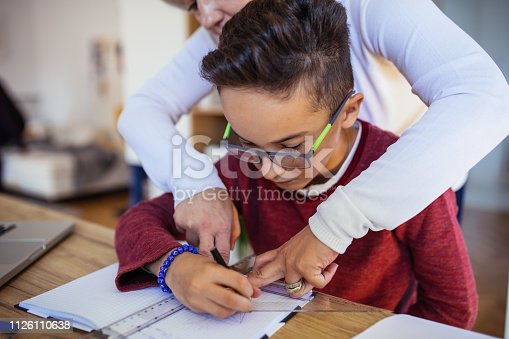 680535874 istock photo Mother helping son with math 1126110638