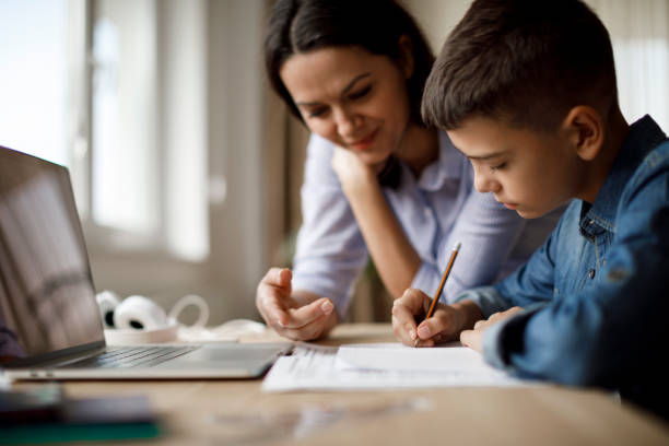 Mother helping teenager with homework Mother helping teenager with homework homework stock pictures, royalty-free photos & images