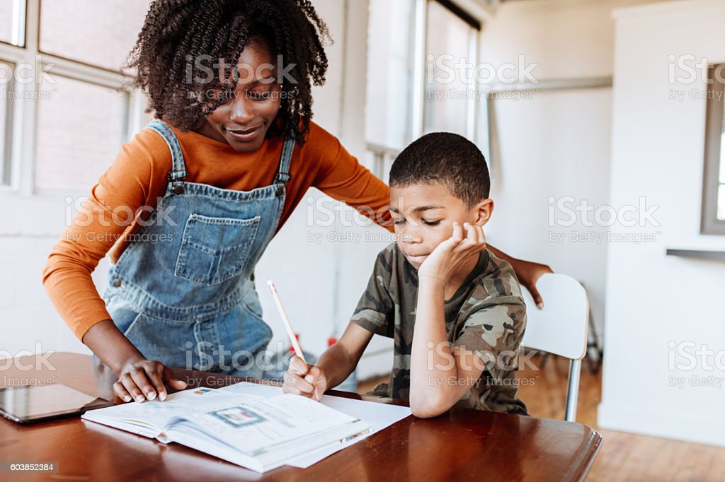 Mother helping with homework stock photo