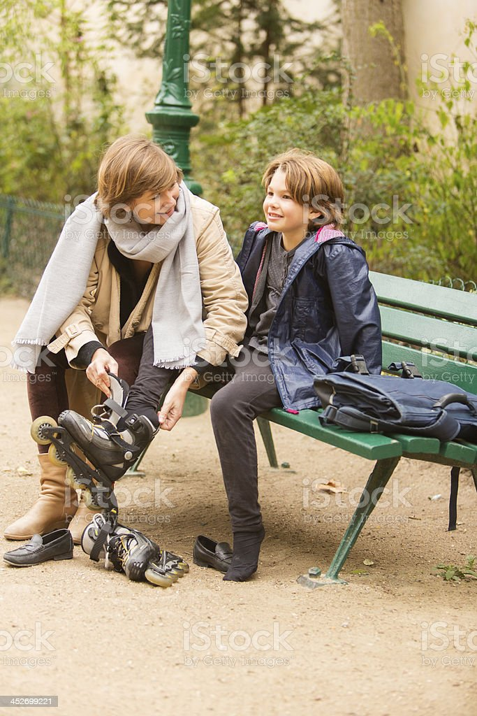 Mother Helping With Rollerblades royalty-free stock photo