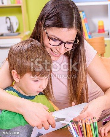 639271192istockphoto Mother Helps Child in Creative Activities 509172128