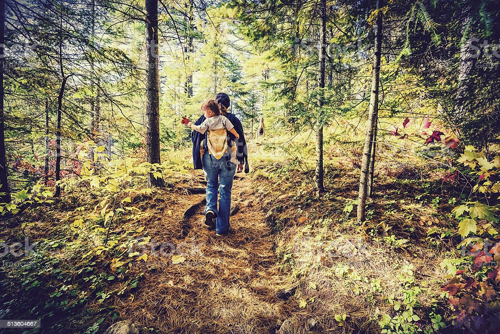 Mother Hiking with Baby - Retro, Faded stock photo