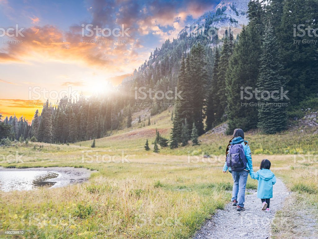 mother hiking with daughter at MT.Rainier stock photo