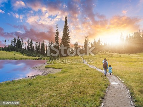 mother hiking with daughter at MT.Rainier, aside Tipsoo Lake, MT.Rainier National Park, WA, USA.