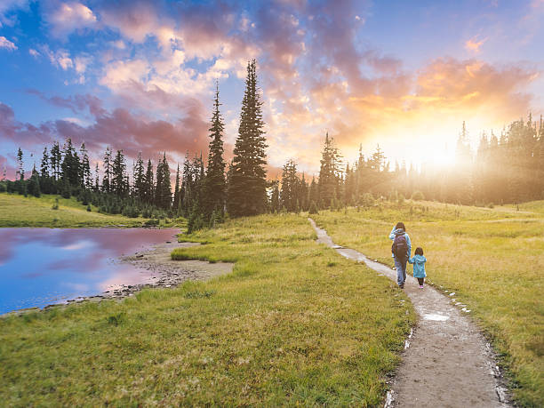 mother hiking with daughter at MT.Rainier mother hiking with daughter at MT.Rainier, aside Tipsoo Lake, MT.Rainier National Park, WA, USA. pierce county washington state stock pictures, royalty-free photos & images