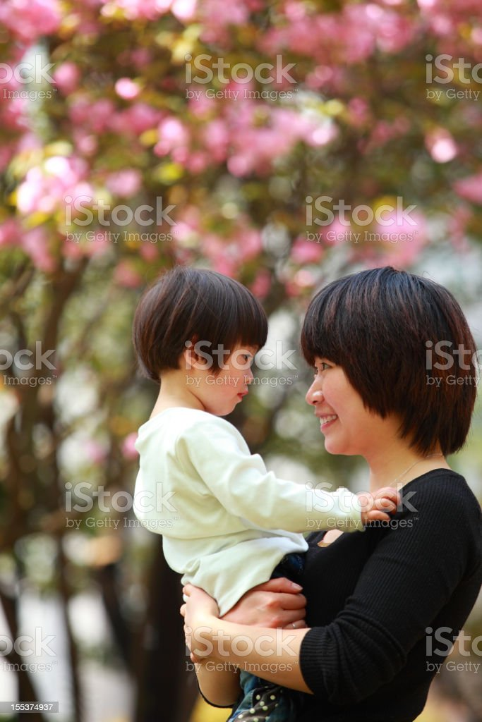 mother hold daughter in the arm royalty-free stock photo