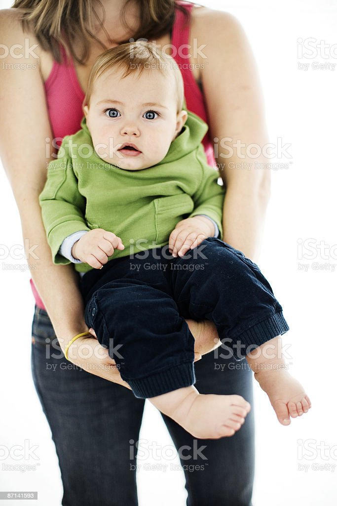 Mother holding 8 month old baby boy royalty-free stock photo