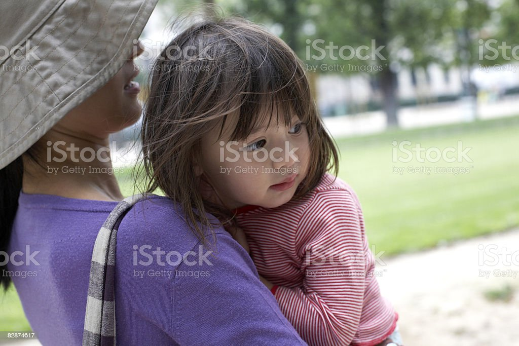mother holding a 2 year old girl foto stock royalty-free