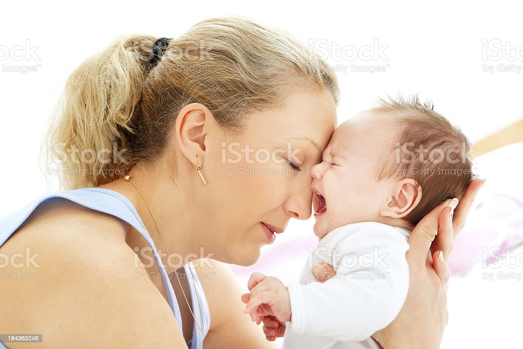 Mother holding and calming 3 months old baby girl royalty-free stock photo