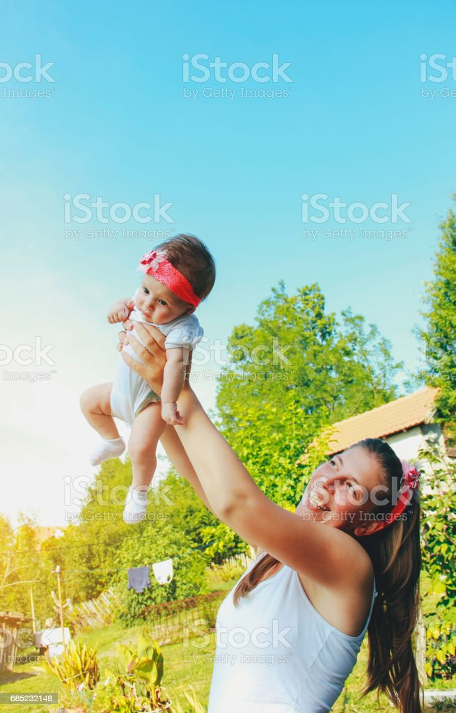 Mother holding baby girl in the nature royalty-free stock photo