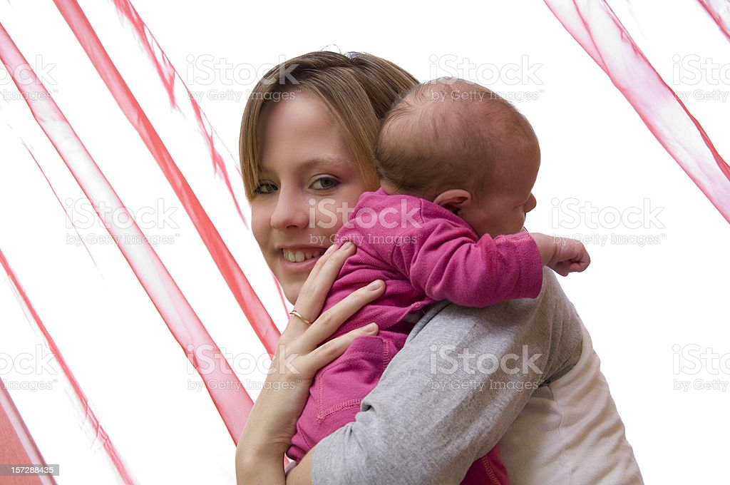 mother holding baby on shoulder royalty-free stock photo