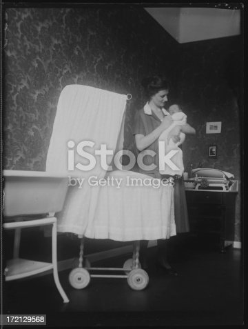 istock Mother holding baby (vintage) 172129568