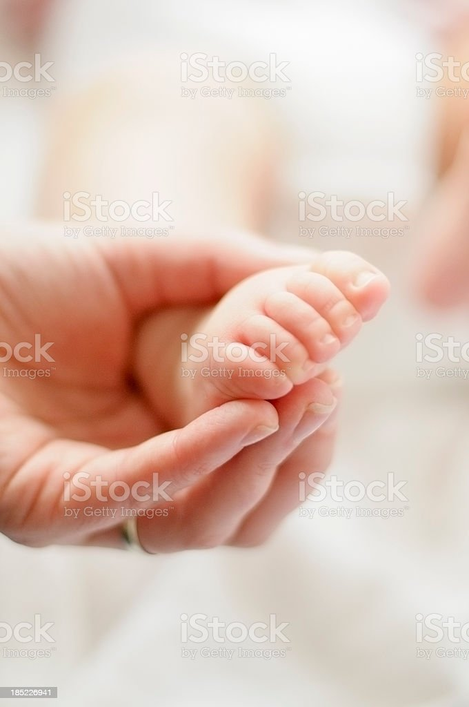 Mother Holding Baby's Foot royalty-free stock photo