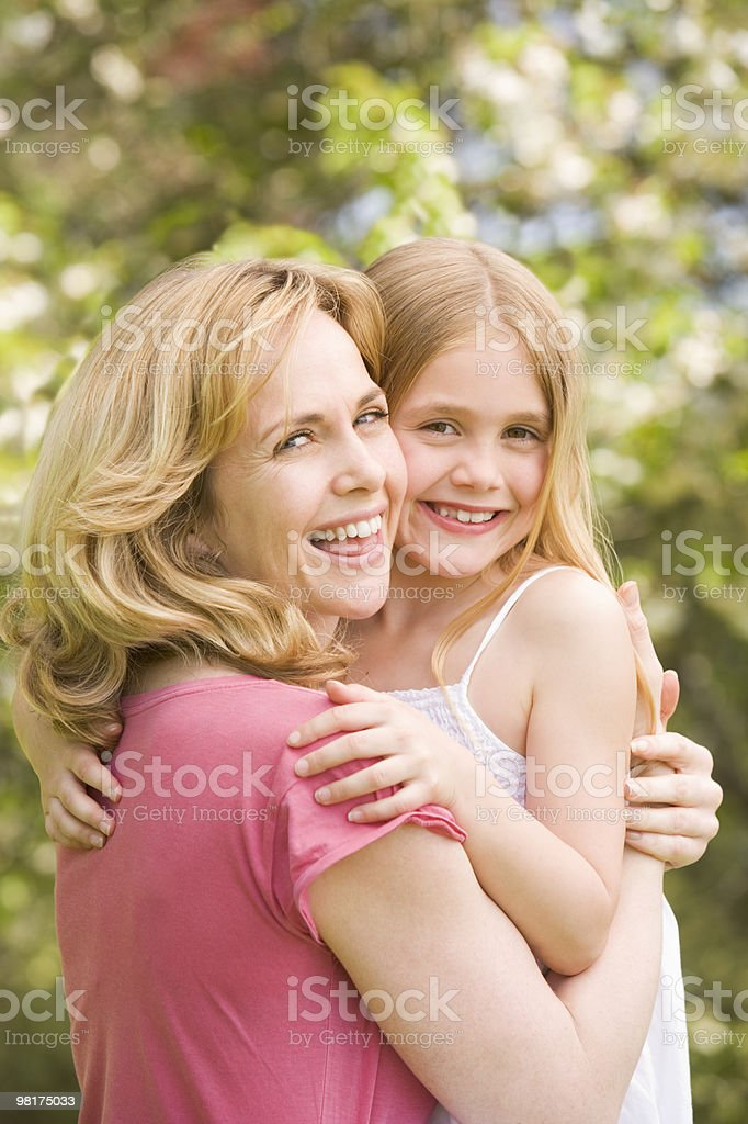 Mother holding daughter outdoors royalty-free stock photo