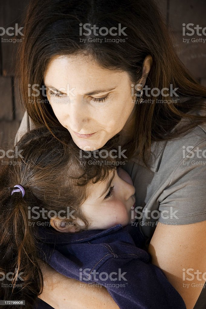 Mother holding daughter (series) royalty-free stock photo