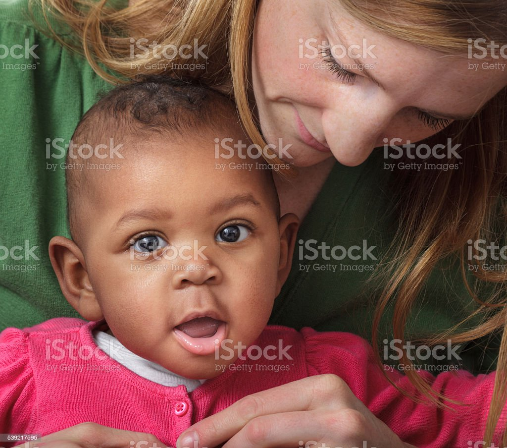 Mother Holding Dressing Adopted Mixed Race Baby Daughter Family Stock Photo Download Image Now Istock