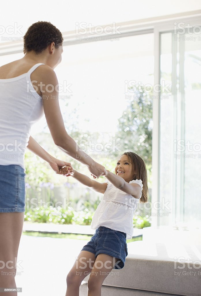 Mother holding hands with daughter 免版稅 stock photo