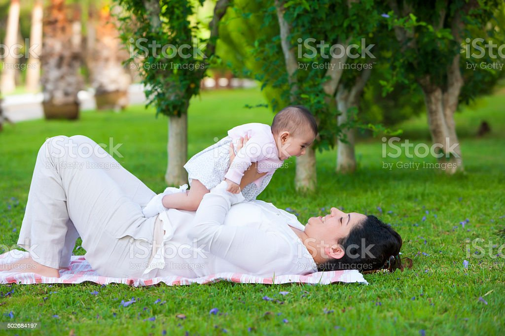 Mother Holding Her Baby Aloft royalty-free stock photo