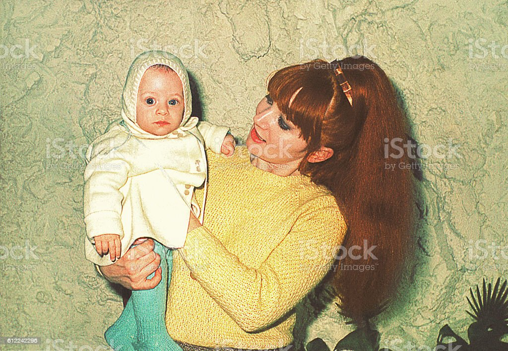 Mother holding her cute little baby stock photo