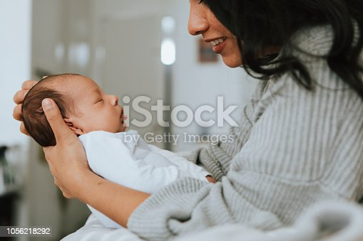 Mother holding her infant baby
