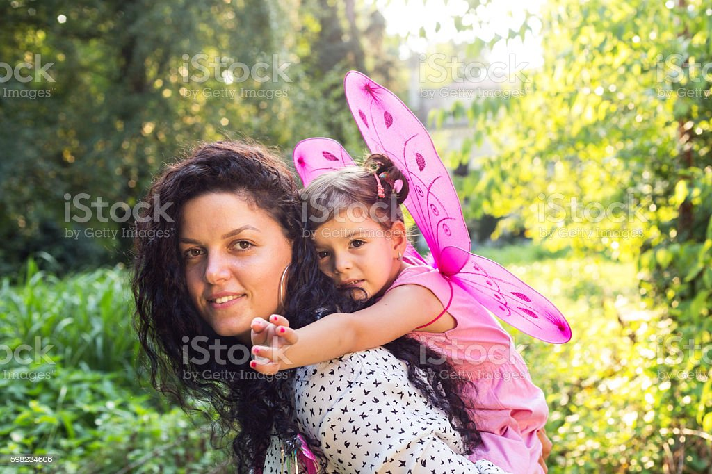 mother holding her little fairy foto royalty-free