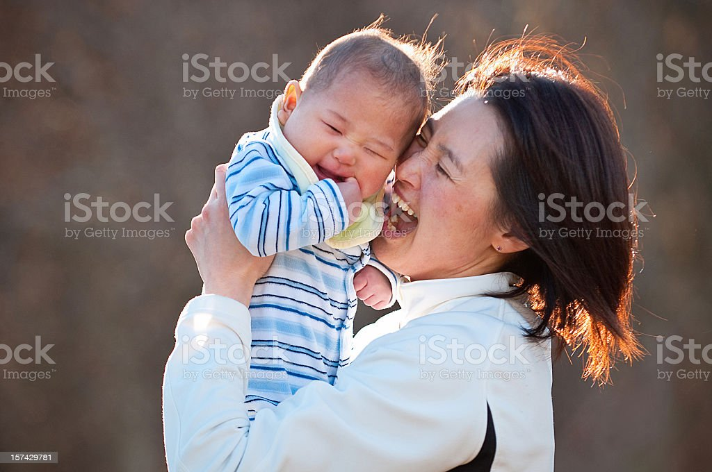 Mother holding her new baby son royalty-free stock photo