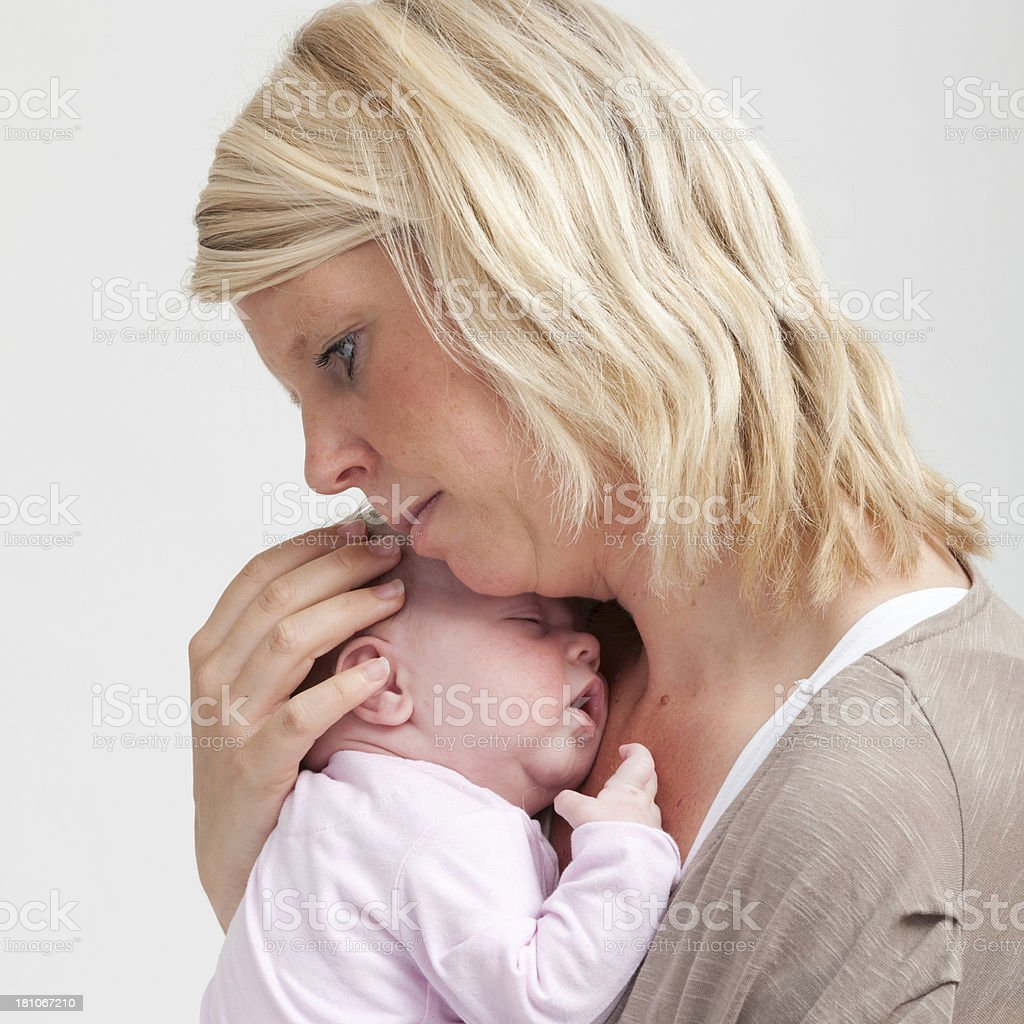 mother holding her new born baby royalty-free stock photo