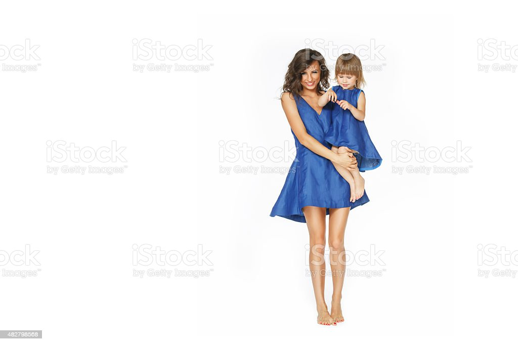 Mother holding little daughter stock photo
