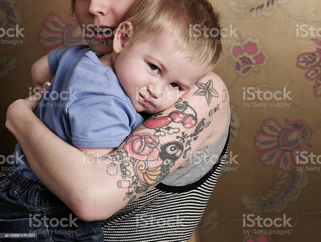 Mother holding son (21-24 months) royalty-free stock photo