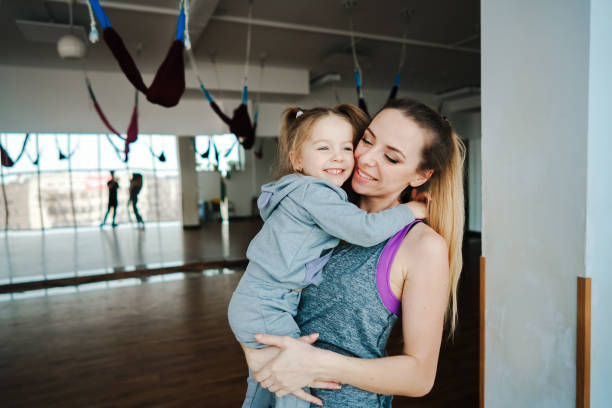 Mother holds her daughter in her arms stock photo