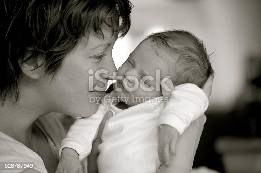 istock Mother holds her newborn baby 526787949