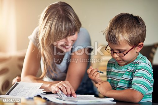 680535874 istock photo Mother homeschooling her son 681062202