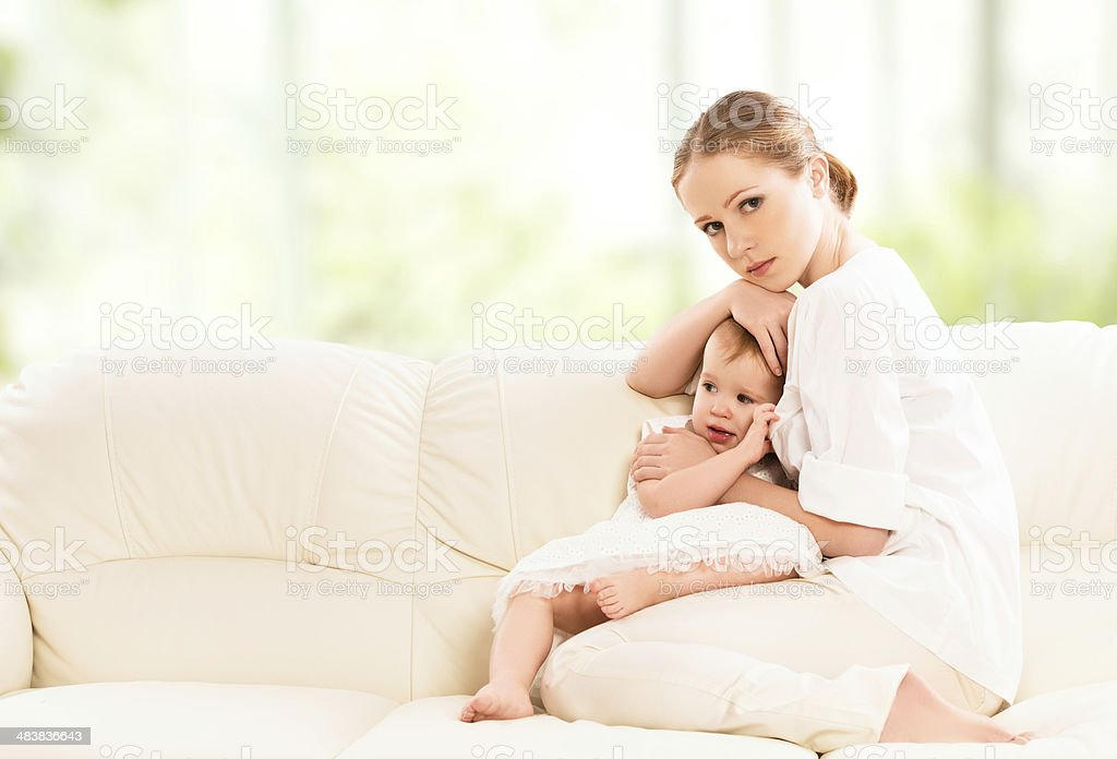 mother hugging and protects her baby  daughter royalty-free stock photo