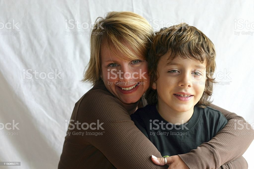 A mother hugging her son for a portrait white background royalty-free stock photo
