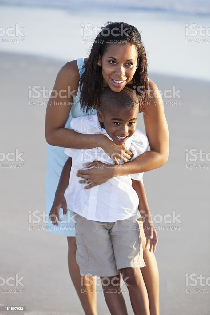 Mother hugging son stock photo