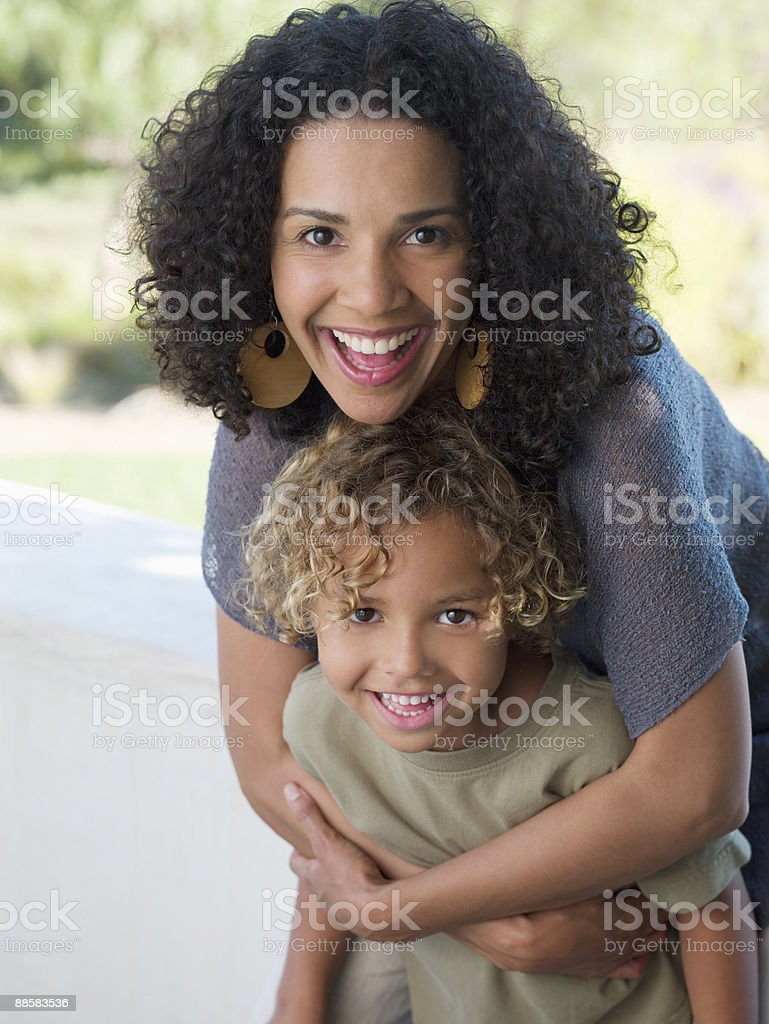 Mother hugging son royalty-free stock photo