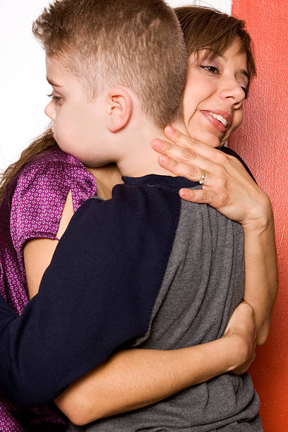 Mother hugs her autistic son stock photo