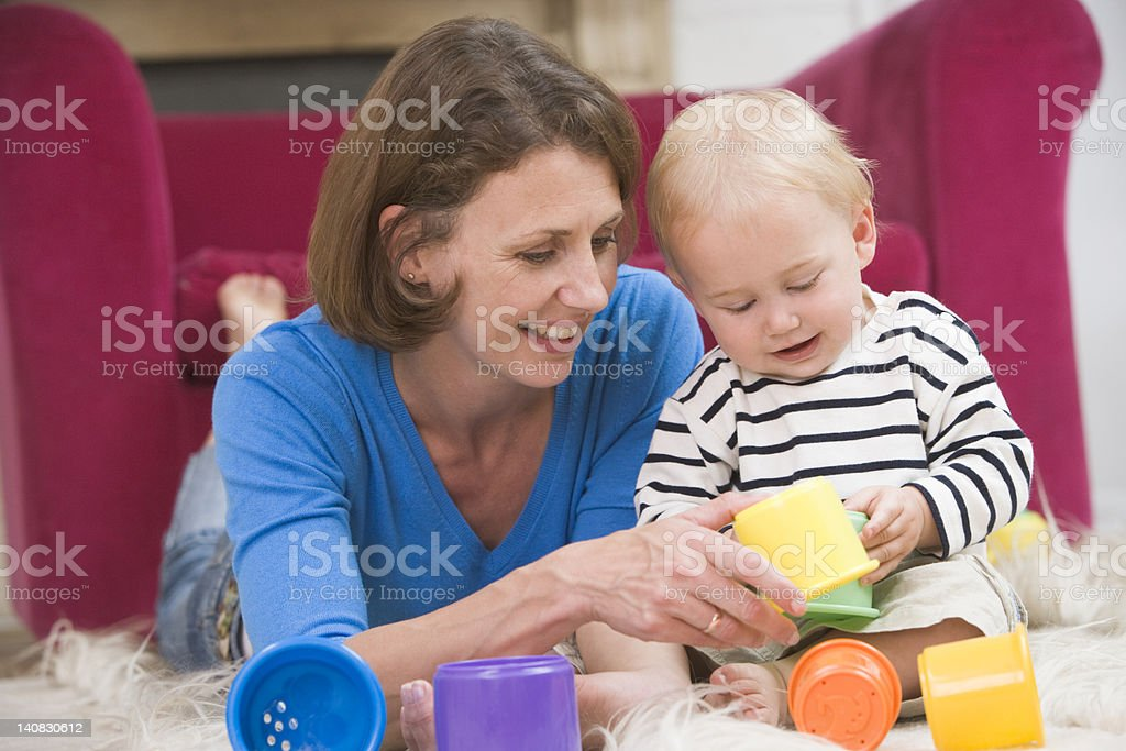 Mother in living room playing with baby royalty-free stock photo