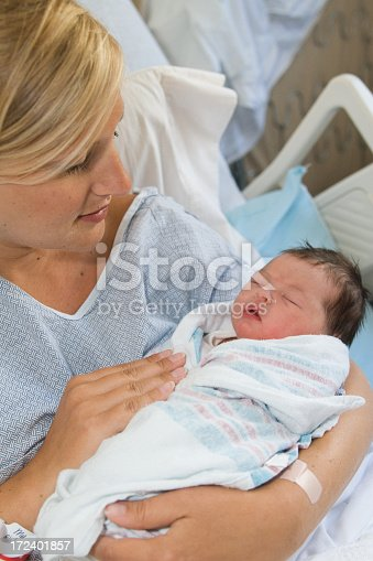 istock A mother in the hospital with her new born baby 172401857