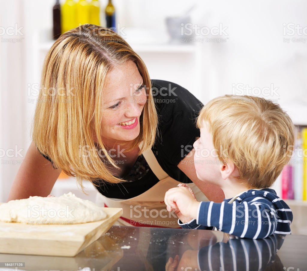 Mother Interacting With Her Son In A Domstic Kitchen royalty-free stock photo