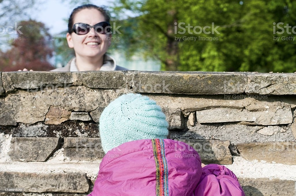Mother is playing with  daughter hide and seek royalty-free stock photo