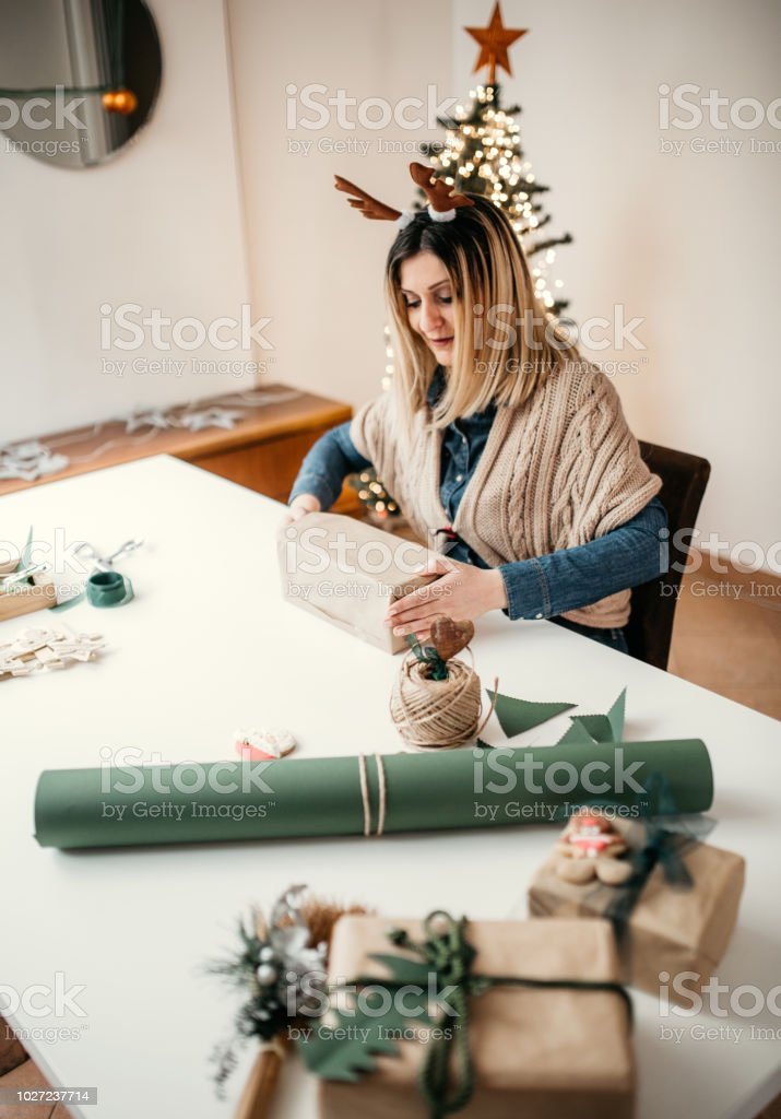 Mother is preparing christmass presents for kids
